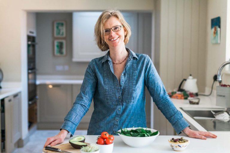 Female nutritionist preparing food in her kitchen