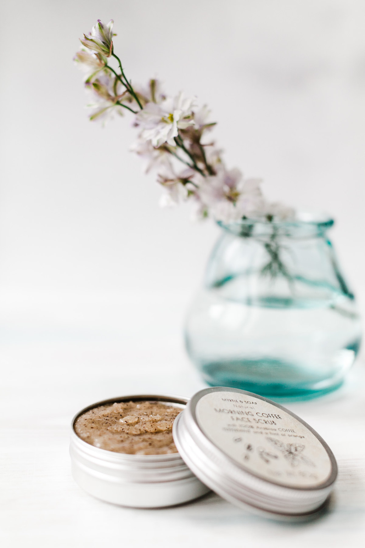 Product photography showing eco friendly skincare and flowers