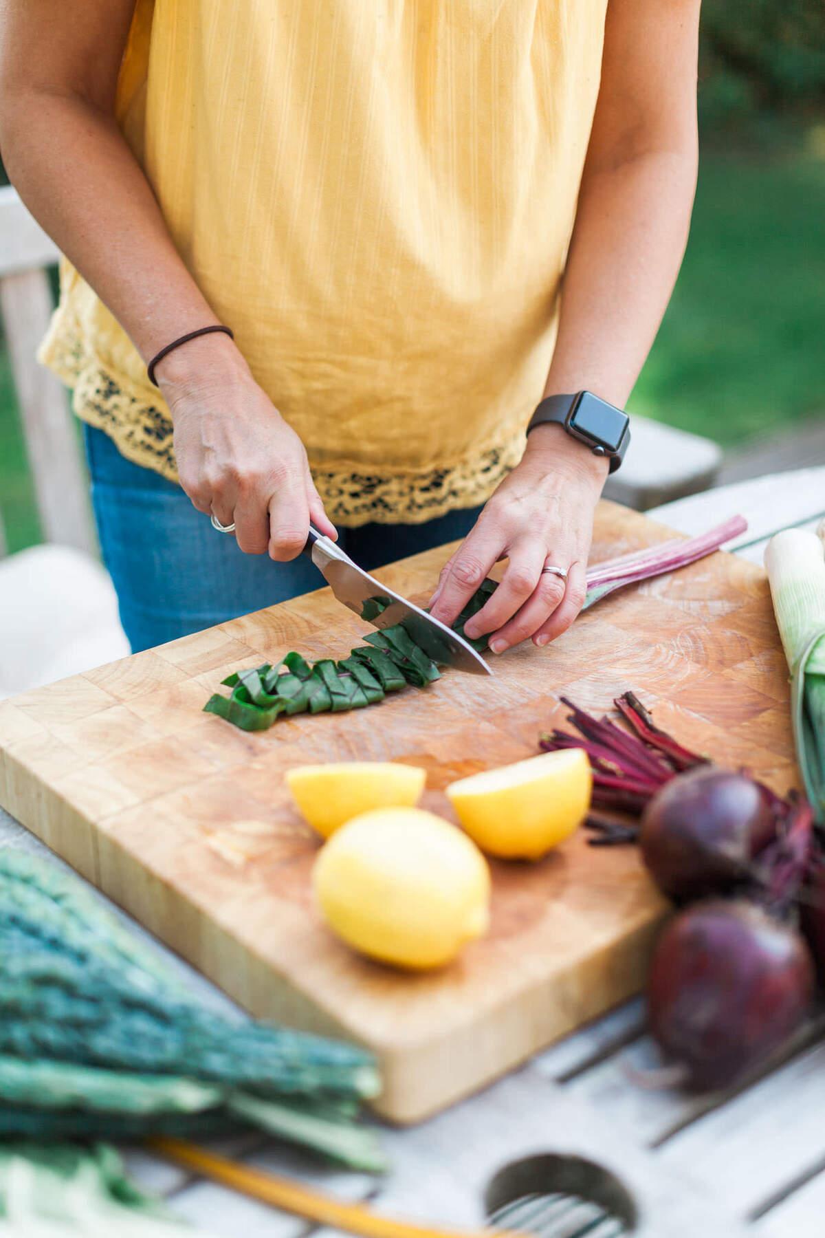 Branding shoot for female nutritionist, cutting vegetables