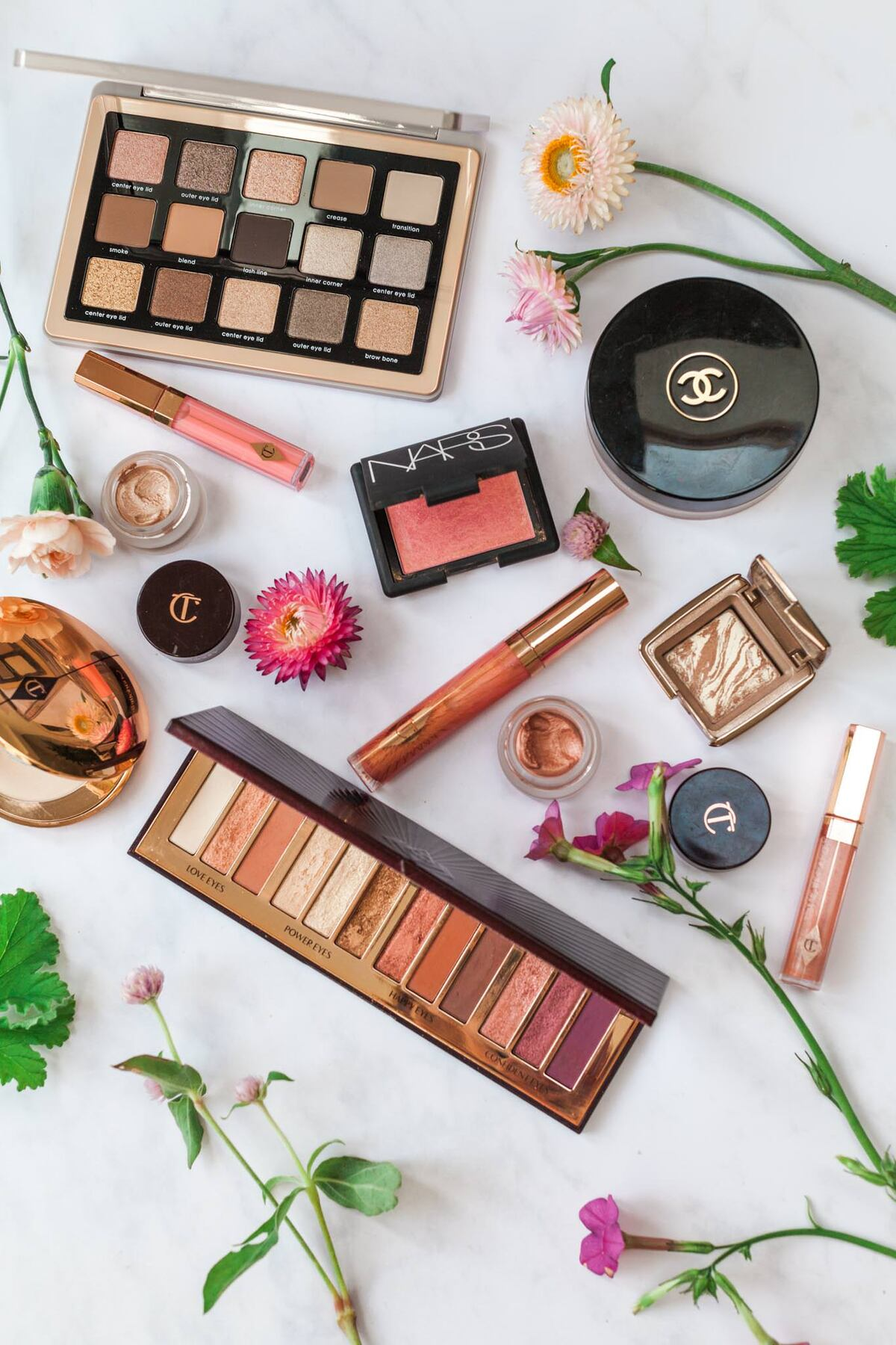 Flat lay of make up and flowers