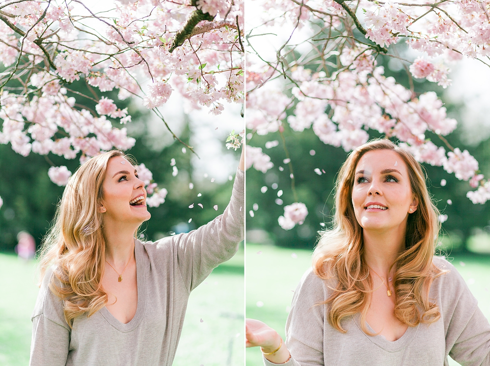 Branding headshot photo by Emma Jackson Photography of a woman in a neutral top standing amongst pink blossom smiling and watching the petals fall